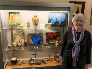 Bea shows off some of her projects, created with her exploration into art at The Knolls